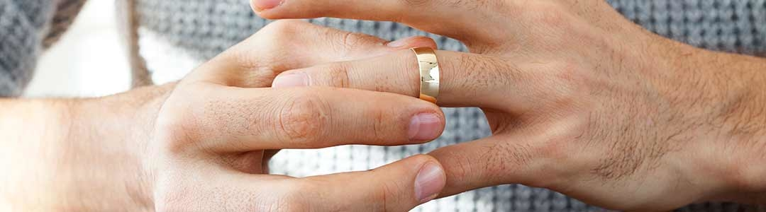 man removing wedding ring The Webster Law Firm