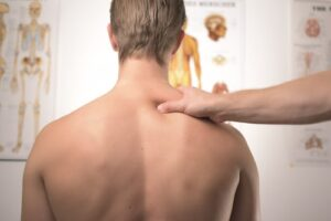 doctor evaluating a patient's back